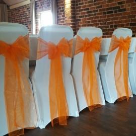 wedding-venue-decorations-birmingham-amy-victoria-orange-chair-sashes