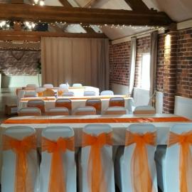 wedding-venue-decorations-birmingham-amy-victoria-orange-chair-sashes-orange-table-runner