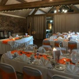 wedding-venue-decorations-birmingham-amy-victoria-orange-chair-sashes-orange-table-runners